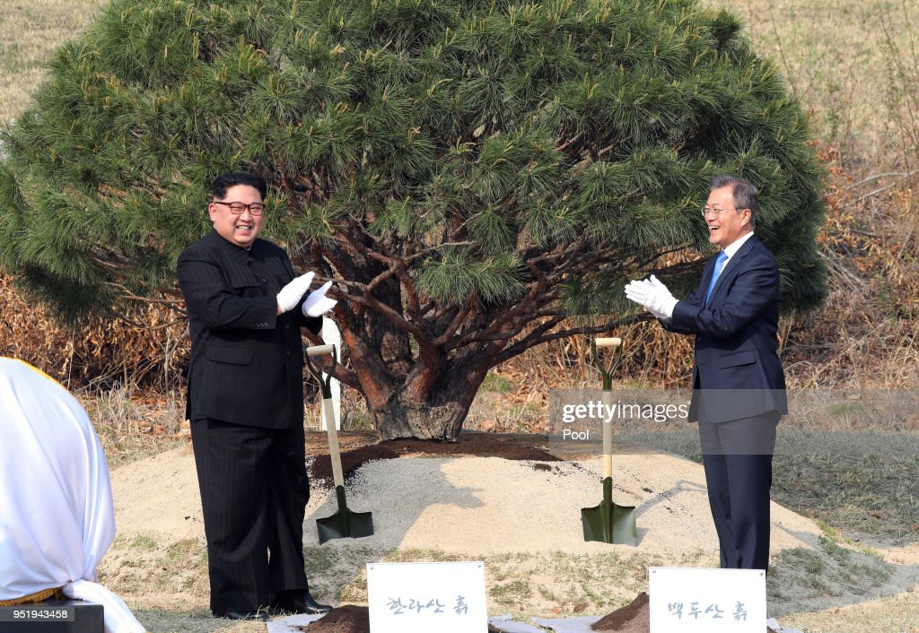 North Korean leader Kim Jong Un (L) and South Korean President Moon Jae-in (R) attend the tree planting ceremony during the Inter-Korean Summit on April 27, 2018 in Panmunjom, South Korea. Kim and Moon meet at the border today for the third-ever Inter-Korean summit talks after the 1945 division of the peninsula, and first since 2007 between then President Roh Moo-hyun of South Korea and Leader Kim Jong-il of North Korea.