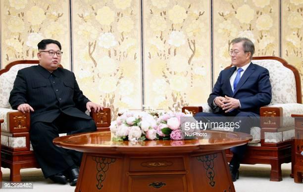 North Korean leader Kim Jong Un and South Korean President Moon Jaein talk during the InterKorean Summit on April 27 2018 in Panmunjom South Korea...