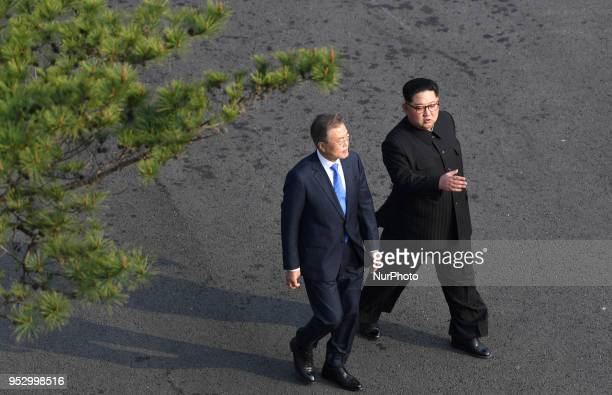 North Korean leader Kim Jong Un and South Korean President Moon Jaein walk during the InterKorean Summit April 27 2018 in Panmunjom South Korea Kim...