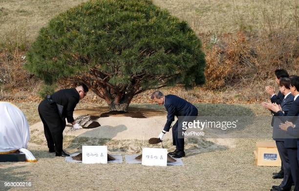North Korean leader Kim Jong Un and South Korean President Moon Jae-in during a tree planting ceremony during the Inter-Korean Summit on April 27,...