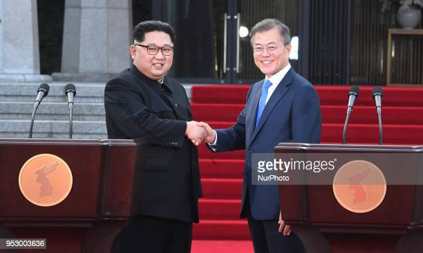 North Korean leader Kim Jong Un and South Korean President Moon Jaein shake hands after announcing the Panmunjom Declaration for Peace Prosperity and...