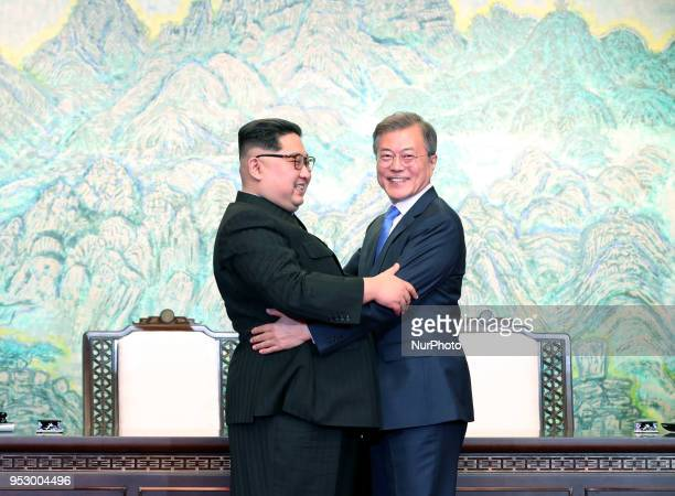 North Korean leader Kim Jong Un and South Korean President Moon Jaein embrace after signing the Panmunjom Declaration for Peace Prosperity and...
