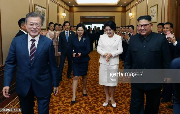 North Korean leader Kim Jong Un guides South Korean President Moon Jae-in and his wife Kim Jung-sook as they arrive at Paekhwawon State Guesthouse...