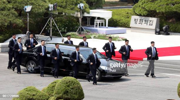 North Korean Leader Kim Jong Un heads to the north side for luncheon in the car escorted by North's bodyguards from the Peace House during the...