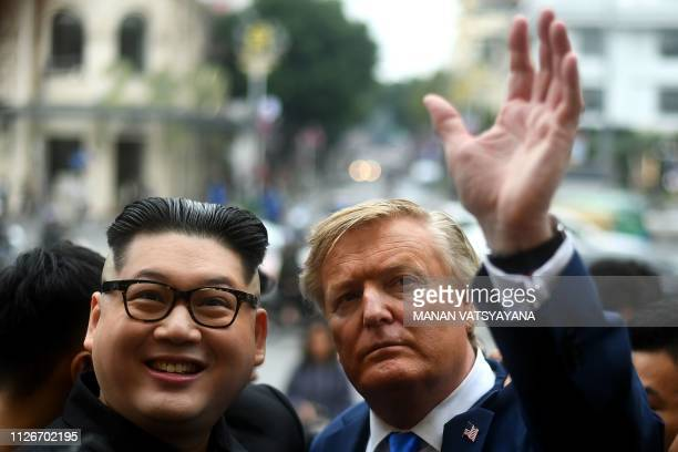 North Korean leader Kim Jong Un impersonator Howard X and US President Donald Trump impersonator Russel White pose together for photographs in Hanoi...