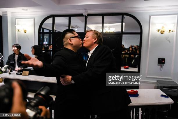North Korean leader Kim Jong Un impersonator Howard X and US President Donald Trump impersonator Russel White pose at a hotel before being escorted...