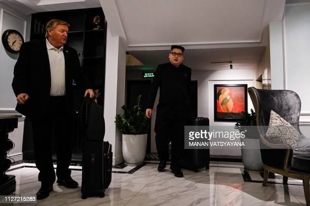 North Korean leader Kim Jong Un impersonator Howard X and US President Donald Trump impersonator Russel White walk at the lobby of a hotel before...