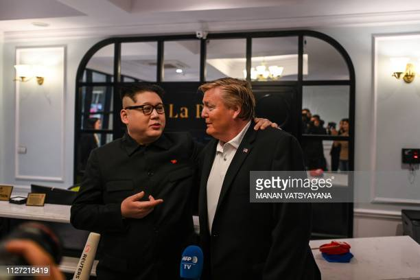 North Korean leader Kim Jong Un impersonator Howard X and US President Donald Trump impersonator Russel White speak to the media at a hotel before...