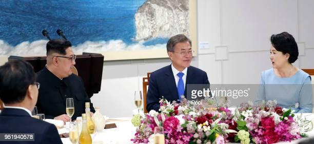 North Korean leader Kim Jong Un , South Korean President Moon Jae-in , and wife Kim Jung-sook attend the Inter-Korean Summit dinner on April 27, 2018...