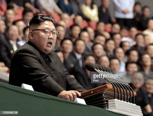 North Korean leader Kim Jong Un speaks after watch the gymnastic and artistic performance at the May Day Stadium on September 19 2018 in Pyongyang...