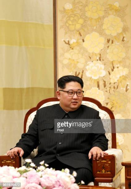 North Korean Leader Kim Jong Un upon his wife Ri Solju's arrival at the Peace House on April 27 2018 in Panmunjom South Korea Kim and Moon meet at...