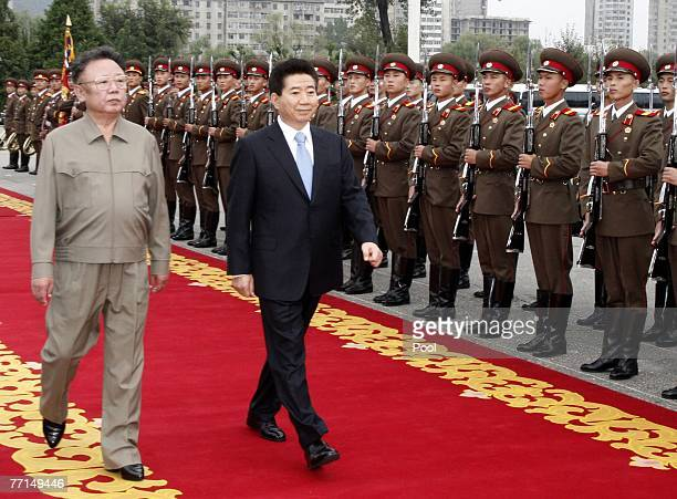 North Korean leader Kim JongIl and South Korean President Roh MooHyun inspect an honour guard together on October 2 2007 in Pyongyang North Korea The...