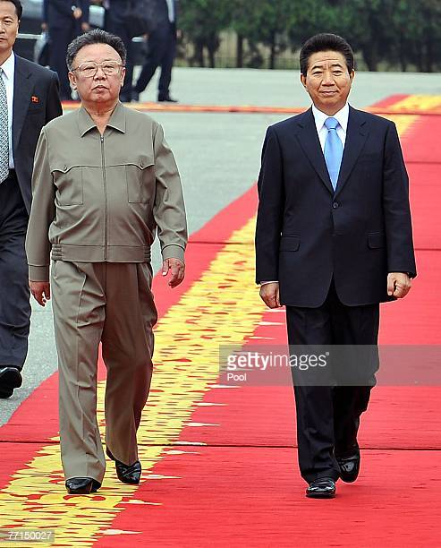 North Korean leader Kim JongIl and South Korean President Roh MooHyun review the honour guard during a welcoming ceremony on October 2 2007 in...