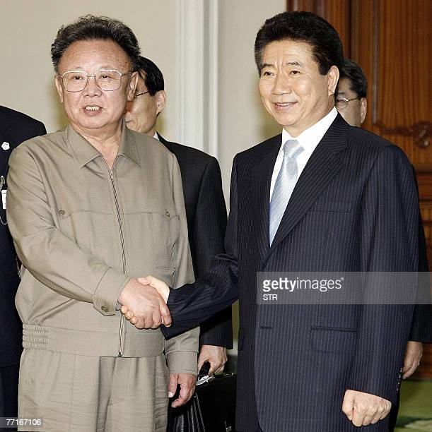 North Korean Leader Kim JongIl and South Korean President Roh MooHyun shake hands following their second round of talks during the two Korea summit...