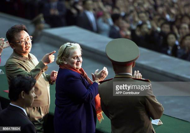 North Korean leader Kim JongIl gestures as US Secretary of State Madeleine Albright and an unidentified military official applaud during a...