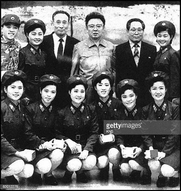 North Korean leader Kim JongIl poses with members of North Korean Peoples Army Youth Propaganda unit while meeting at an undisclosed place 02 January...