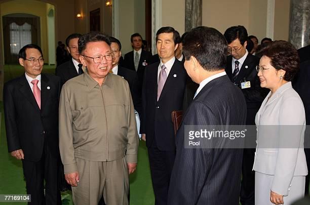 North Korean leader Kim JongIl speaks with South Korean President Roh MooHyun while his wife Kwon YangSook looks on on October 3 2007 in Pyongyang...