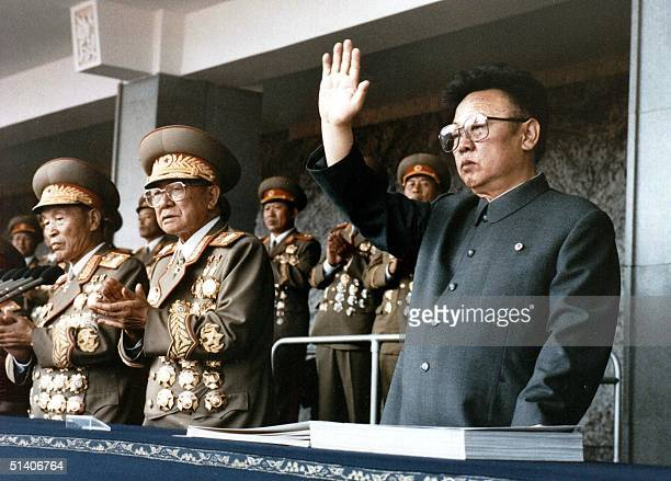 North Korean leader Kim JongIl waves at a military parade to celebrate the 50th anniversary of the founding of the Workers' Party of Korea in a file...