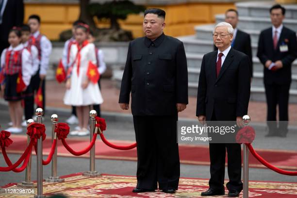 North Korean leader Kim Jongun and Vietnamese President Nguyen Phu Trong during a welcoming ceremony at the President Palace on March 1 2019 in Hanoi...