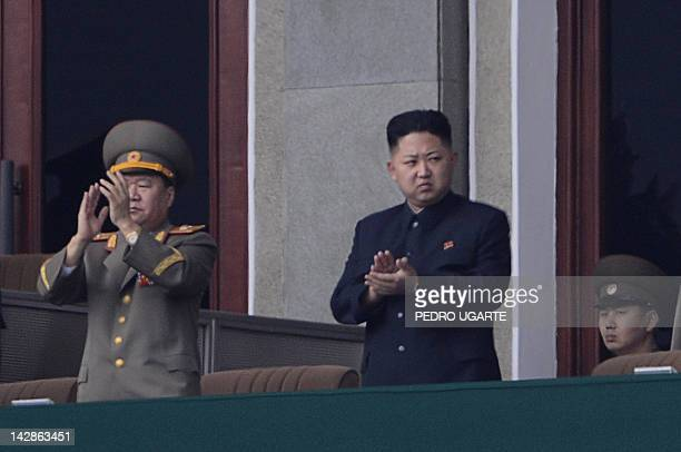 North Korean leader Kim JongUn applauds during a official ceremony at a stadium in Pyongyang on April 14 2012 North Korean will mark the 100th...