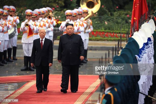 North Korean leader Kim Jongun attends the welcome ceremony with Vietnamese President Nguyen Phu Trong at the Presidential Palace on March 01 2019 in...