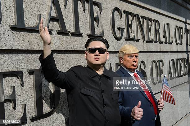 North Korean leader Kim Jongun impersonated by Hong Kong actor Howard and US President Donald Trump impersonated by US actor Dennis pose outside the...