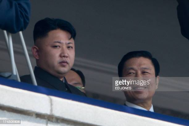 North Korean leader Kim JongUn sits with China's Vice President Li Yuanchao during a military parade at Kim IlSung square marking the 60th...