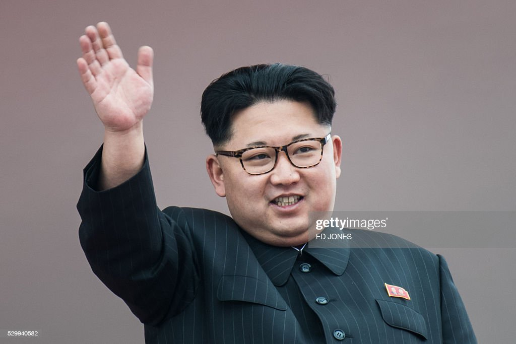 North Korean leader Kim Jong-Un waves from a balcony of the Grand People's Study House following a mass parade marking the end of the 7th Workers Party Congress in Kim Il-Sung Square in Pyongyang on May 10, 2016. North Korea kicked off a massive parade in the centre of Pyongyang on May 10 to celebrate a just-concluded ruling party congress that was seen as a formal coronation for supreme leader Kim Jong-Un. / AFP / Ed Jones