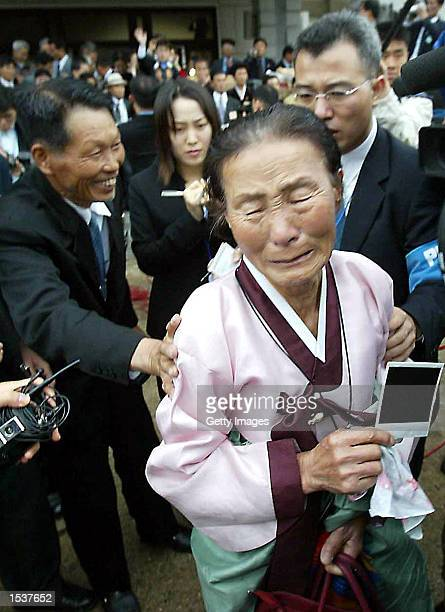 North Korean Lim HanUan writes down family information with his longlost South Korean wife Chung GweUp who never remarried after 52 years of living...