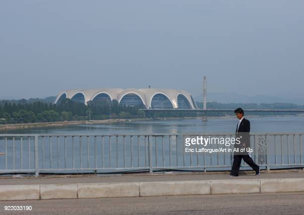 North Korean man along Taedong river with the may day stadium in the back Pyongan Province Pyongyang North Korea on September 9 2008 in Pyongyang...