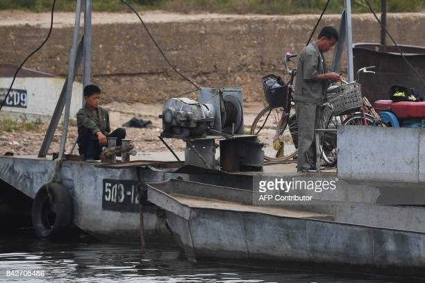North Korean men are seen on a boat ramp on the bank of the Yalu river near the North Korean town of Sinuiju opposite the Chinese border city of...