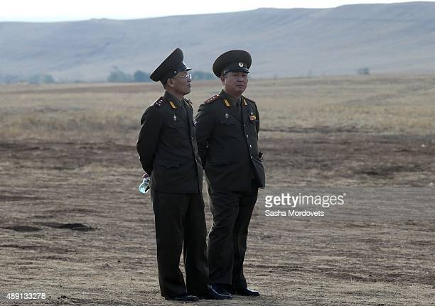 North Korean military officers attend Russias large-scale Center-2015 military exercises at Donguzsky Range September 19, 2015 in Orenburg, Russia,...