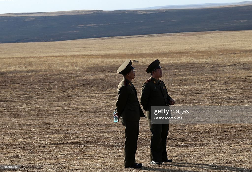 North Korean military officers attend Russias large-scale Center-2015 military exercises at Donguzsky Range September 19, 2015 in Orenburg, Russia, The exercises, aim to contain the outbreak of an armed conflict in Central Asia. Putin said this week that it's impossible to defeat Islamic State group without support of the government of Syria and that Moscow has provided military assistance to President Bashar al-Assad's regime and will continue to do so.