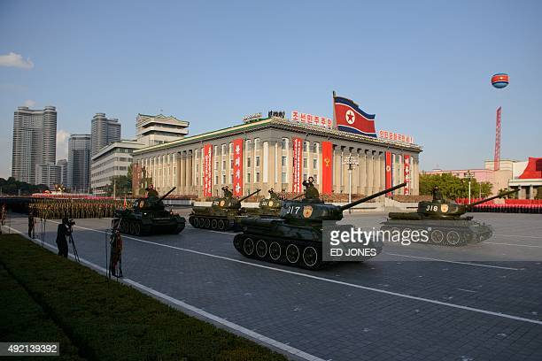 North Korean military vehicles pass through Kim IlSung square during a mass military parade in Pyongyang on October 10 2015 North Korea was marking...