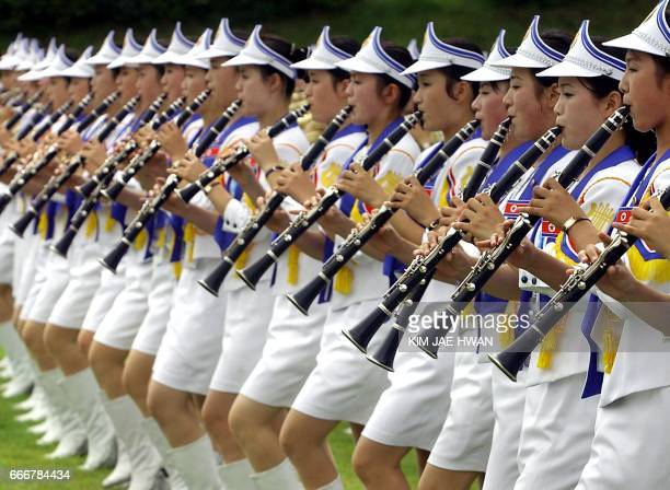 North Korean musicians and cheer learders perform during the welcoming ceremony in Daegu 21 August 2003 North Korean athletes and cheer leaders are...