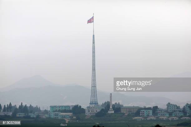 North Korean national flag in North Korea's propaganda village of Gijungdong is seen from an observation post on July 12 2017 in Panmunjom South...
