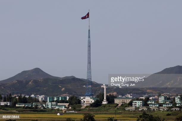 North Korean national flag in North Korea's propaganda village of Gijungdong is seen from an observation post on September 28, 2017 in Panmunjom,...