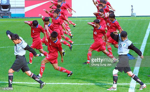 North Korean national soccer players work out during a practice session the day before a friendly match against South Korea at the Sangam World Cup...