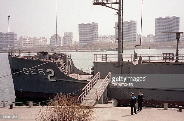 North Korean navy ratings guard the USS Pueblo an American spy ship on the river Taedong in central Pyongyang 16 April 2001 The ship was attacked and...