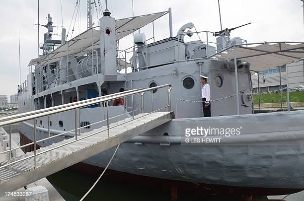 A North Korean navy seaman stands aboard the USS Pueblo a US navy technical research ship captured by North Korean forces in 1968 in Pyongyang on...
