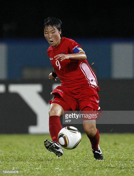 North Korean O Hui Sun controls the ball during the FIFA Women's Under17 semifinal match against Japan on September 21 at the Ato Boldon Stadium in...