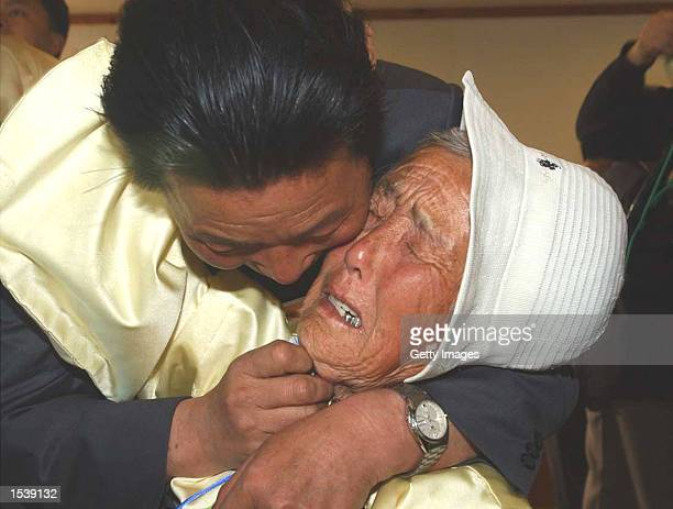 North Korean Oh YooBum hugs his sister Oh MiSaeng of South Korea during a reunion of families from the two countries May 1 2002 at the Mount Kumgang...