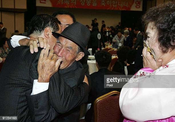 North Korean Park ChunShik meets with his South Korean relatives during a separated family reunion meeting at the Mount Kumgang resort on September...