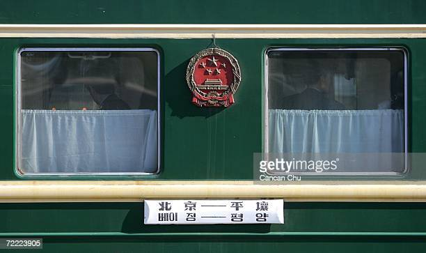 North Korean passengers wait for the start in a train from Beijing to Pyongyang at the railway station on October 20 2006 in the Chinese border city...
