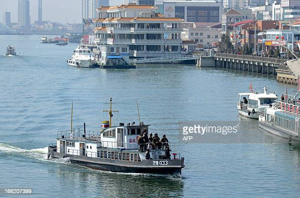 A North Korean patrol boat cruises the Yalu River between the North Korean town of Sinuiju and the Chinese border town of Dandong on April 10 2013...