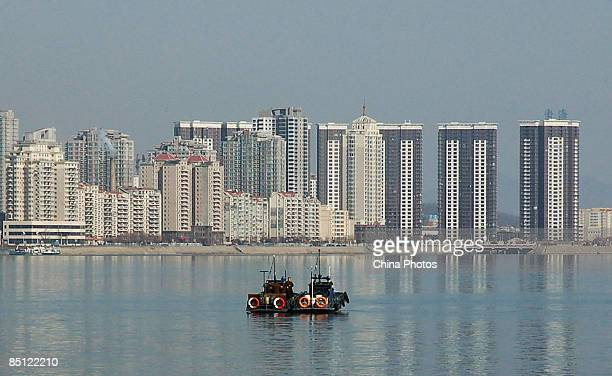 North Korean patrol boats cruise the Yalu River on February 26, 2009 in Dandong of Liaoning Province, China. The Yalu River, now a tourist attraction...