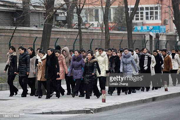 North Korean people arrive at the North Korea Embassy to mourn the death of North Korean leader Kim Jongil on December 29 2011 in Beijing China...