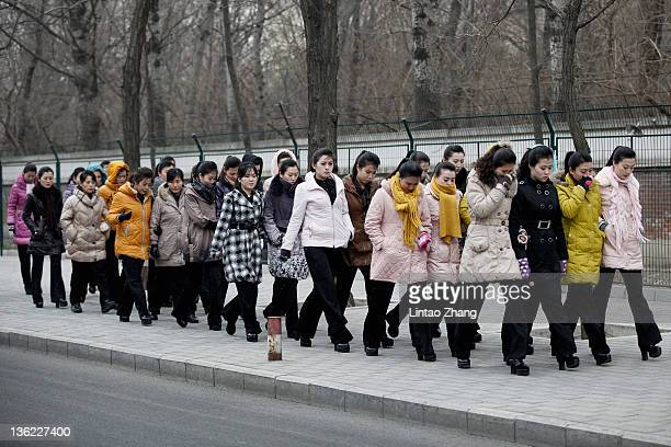 North Korean people arrives at the North Korea Embassy to mourn the death of North Korean leader Kim Jongil on December 29 2011 in Beijing China...