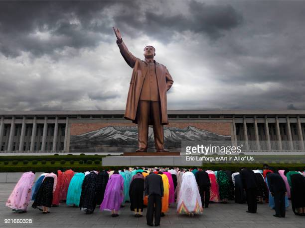 North Korean people bowing in front of Kim il Sung statue in Mansudae Grand monument, Pyongan Province, Pyongyang, North Korea on April 12, 2008 in...