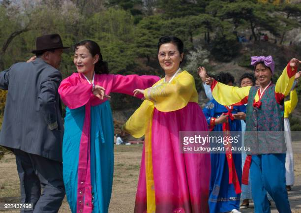 North Korean people dancing in a park for the day of the sun which is the birth anniversary of Kim Ilsung Pyongan Province Pyongyang North Korea on...